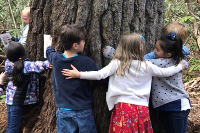 Kids hugging tree